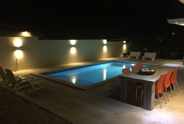 Preview a overview pool dinertable beach chairs night villa breeze curacao